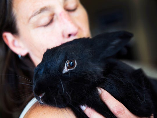 Larisa Byerhof holds her rabbit, Sweetums,