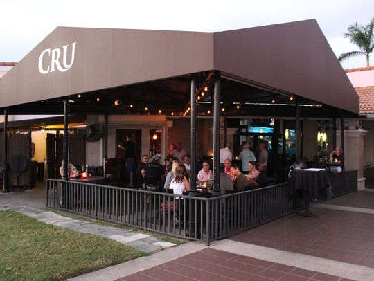 The outdoor bar at Cru has a casual cool vibe and is