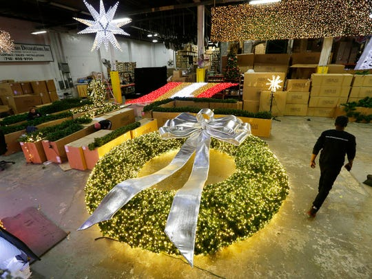 A huge wreath is prepared for a client at the American