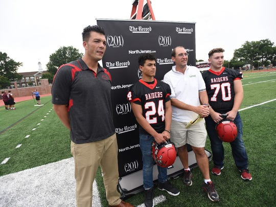 The Record's Darren Cooper posing with Cliffside Park football coach Tom Mandile, Manuel Amaro (24) and Dave Berberian (70) during NJSFC Media Day at Clifton Stadium on Aug. 14.