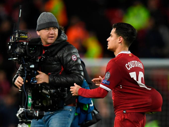 Liverpool's Philippe Coutinho leaves the pitch with