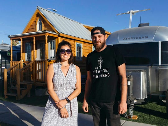 In this Nov. 14, 2017, photo Jennifer Taler and Brad Johnson pose for a photo in Las Vegas. In downtown Las Vegas, what started about three years ago as Zappos CEO Tony Hsieh's experiment of about 30 Airstream trailers and tiny homes has turned into a community that is now called Fergusons Downtown.