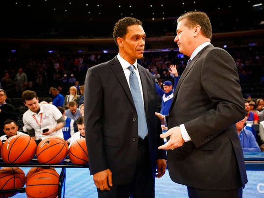 Monmouth head coach King Rice and Kentucky head coach John Calipari speak before an NCAA college basketball game at Madison Square Garden in New York, Saturday, Dec. 9, 2017.  (Alex Slitz/Lexington Herald-Leader via AP)