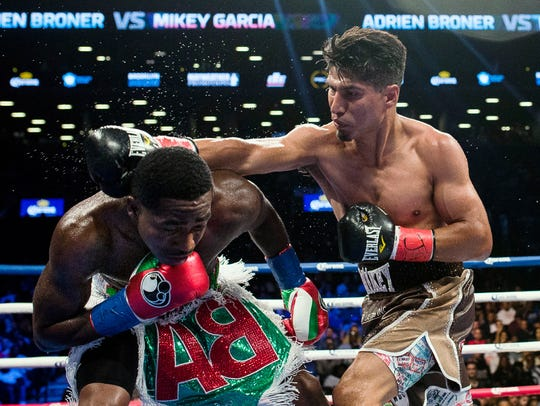 Mikey Garcia throws a punch at Adrien Broner during their fight last July.