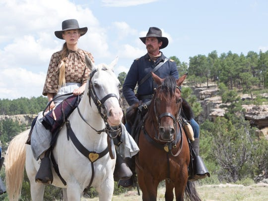 "Rosamund Pike and Christian Bale star in ""Hostiles."""