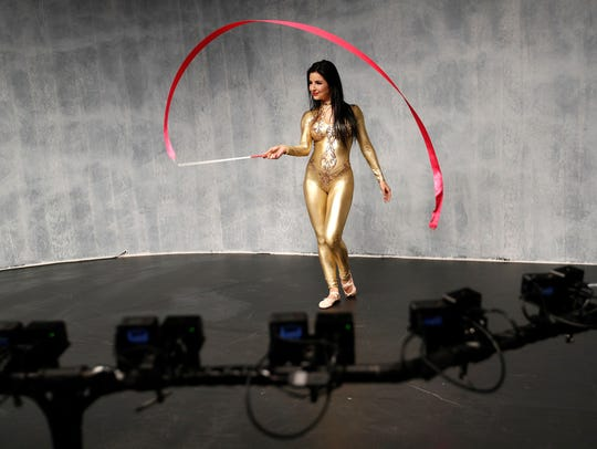 A model performs at a display for Sony RX0 cameras