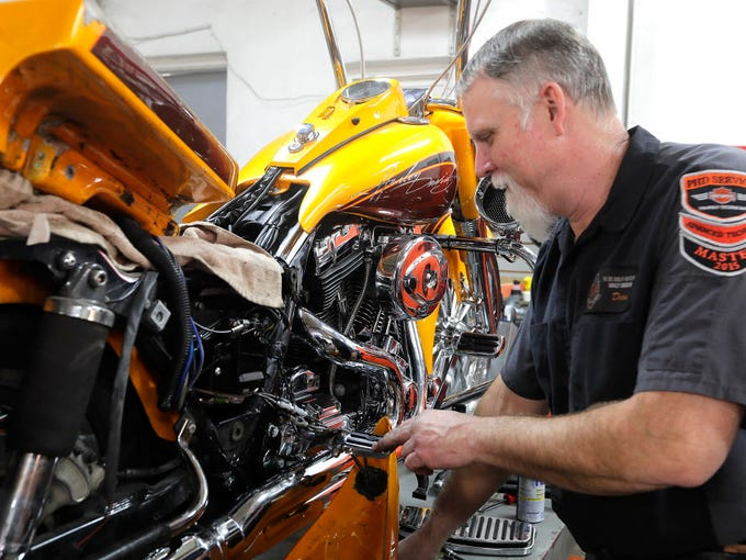 Dean Colegrove, a 30-year veteran mechanic, works on