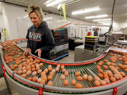 Julie Teunissen helps package eggs at Blue Sky Family Farms in Cedar Grove, an organic egg farm she operates with her husband, Matthew.