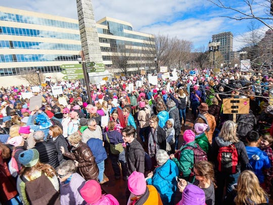 Creative signs and all walks of life gathered at the Women's March in Asheville on Jan. 20, 2018.