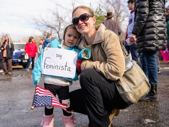 Creative signs and all walks of life gather for the Women's March in Asheville on Jan. 20, 2018.