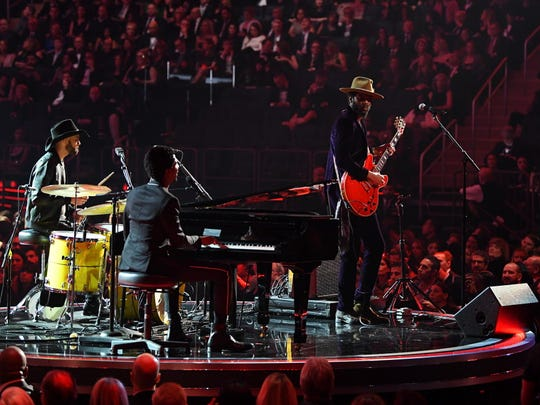 Gary Clark Jr. (on guitar), Jon Batiste (piano) and Joe Saylor (drums).