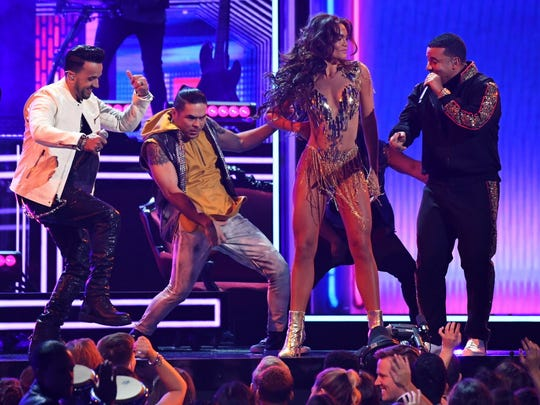Luis Fonsi and Daddy Yankee, featuring Zuleyka Rivera (center).