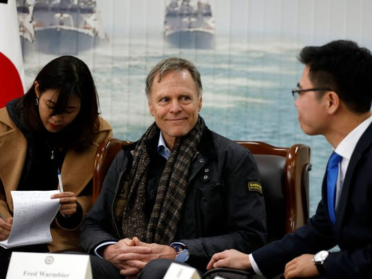 PYEONGTAEK, SOUTH KOREA - FEBRUARY 09: Fred Warmbier(C), the father of Otto warmbier who was imprisoned in North Korea for 17 months smiles on Ji Seong-ho(R), North Korean defector at the meeting room in the South Korean Navy 2nd Fleet Commnad on February 9, 2018 in Pyeongtaek, South Korea. The U.S. Vice President Mike Pence is visiting South Korea and will lead the U.S. delegation in the opening ceremony of PyeongChang Winter Olympic Games.  (Photo by Woohae Cho/Getty Images)