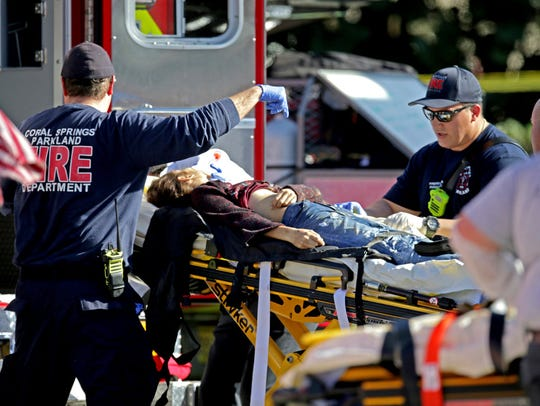 Medical personnel tend to a victim after a shooting