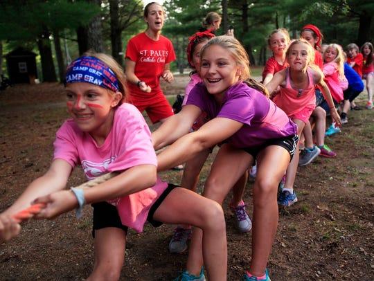 Summer campers enjoy a game of tug-of-war.