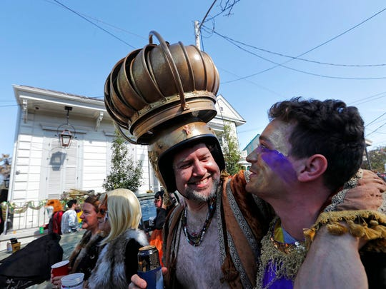 A man uses an attic vent as headgear during the Society de Sainte Anne parade, on Mardi Gras day in New Orleans, Tuesday, Feb. 13, 2018.
