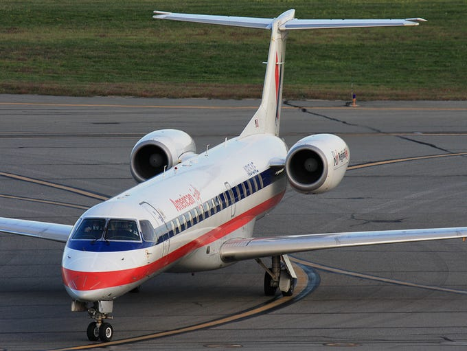 An American Eagle Embraer E145 taxis at T.F. Green