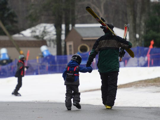 Chance Parker, of Ramsey and his then-four year old son, Dean, toCampgawThursday morning. The light rain and snow falling onCampgawMountain in 2016.