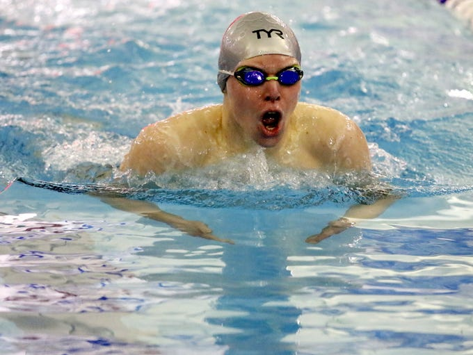 Michael Schultz of Chenango Valley swims to a win in
