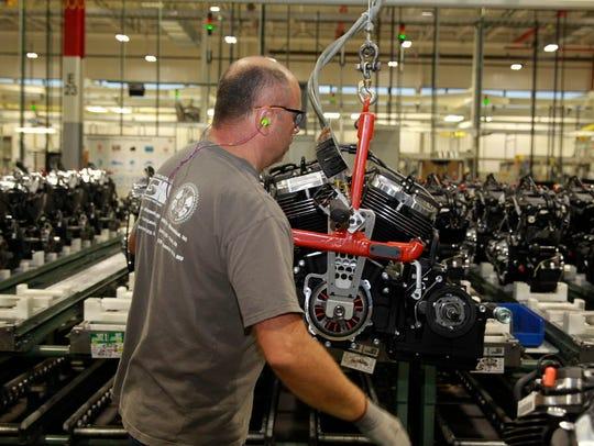 Gregg Trobentar works on the engine assembly line at