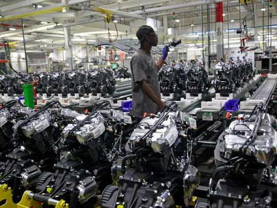 A Harley-Davidson employee at the Menomonee Falls plant, last September, works on the engine assembly line. Speaker of the House Paul Ryan was  touring the facility.
