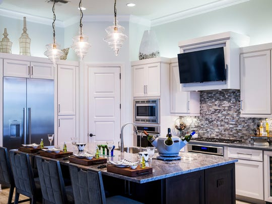 The kitchen of the Aviano, a three-bedroom, fully furnished luxury model home built by Harbourside Custom Homes, in the exclusive gated village of Marsh Cove within the Fiddler's Creek community.
