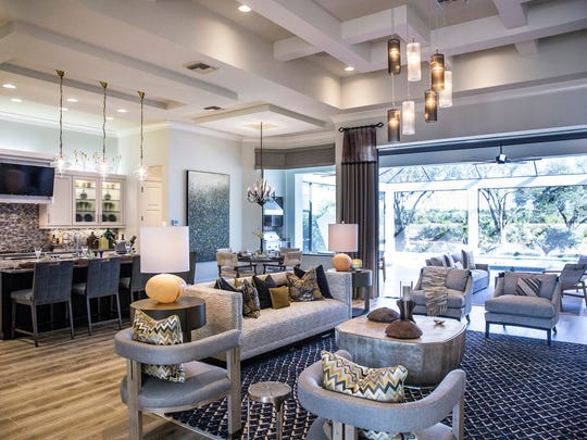 The living space of the Aviano, a three-bedroom, fully furnished luxury model home built by Harbourside Custom Homes, in the exclusive gated village of Marsh Cove within the Fiddler's Creek community.