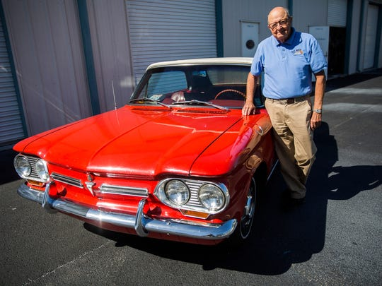 John McNally stands next to his red 1962 Chevrolet Corvair outside of a Naples car garage on Jan. 31, 2018.