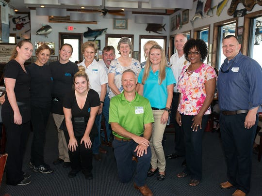 Attendees at the 2017 Local Celebrity Lunch: (top row, from left to right) Chuck's Seafood Restaurant staff, St. Lucie County Commissioner Frannie Hutchinson, St. Lucie County School Board Member Debbie Hawley, St. Lucie Public Schools Chief Communications Officer Kerry Padrick, St. Lucie Fire Chief Buddy Emerson; (bottom row, from left to right) St. Lucie County Tax Collector Chris Craft, St. Lucie County Property Michelle Franklin, St. Lucie County School Board Member Dr. Donna Mills and City of Fort Pierce Commissioner Jeremiah Johnson.