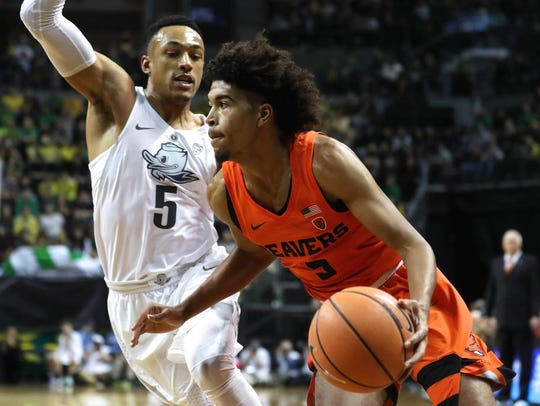 OSU freshman guard Ethan Thompson (right) showed promise