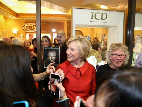 Hillary Clinton greets supports supporters a month