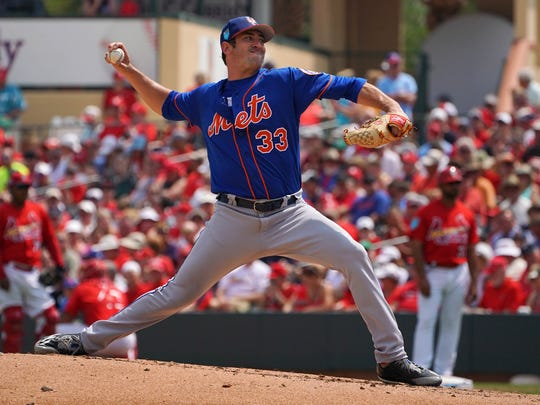 Mar 20, 2018; Jupiter, FL, USA; New York Mets starting pitcher Matt Harvey (33) delivers a pitch in the third inning against the St. Louis Cardinals of a spring training game at Roger Dean Stadium.