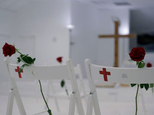 A memorial for the victims of the shooting at Sutherland Springs Baptist Church includes 26 white chairs, each painted with a cross and and rose, placed in the sanctuary Nov. 12, 2017, in Sutherland Springs, Texas.