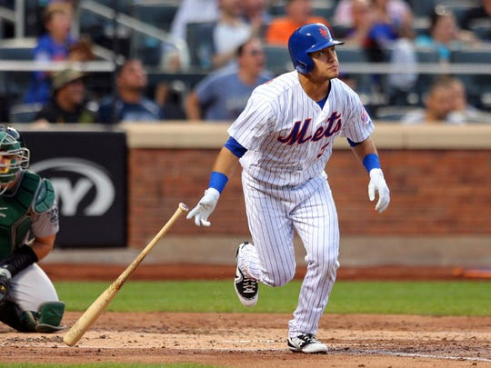 Jul 21, 2017; New York City, NY, USA; New York Mets center fielder Michael Conforto (30) watches his two run home run against the Oakland Athletics during the third inning at Citi Field.