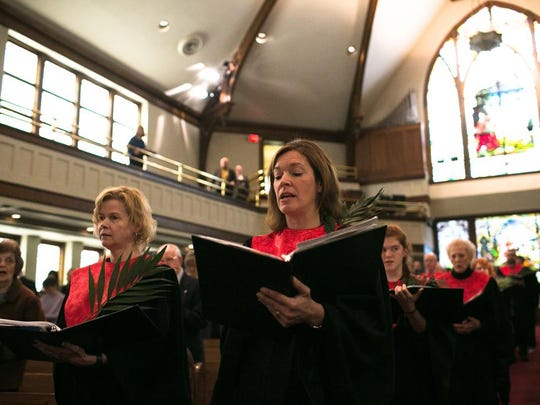 Jennifer Russ; at right, processes in with the choir