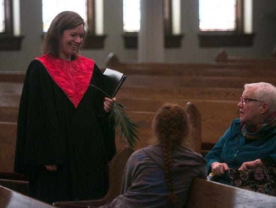 Jennifer Russ talks with congregation members as Central