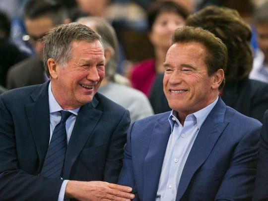 Former California governor Arnold Schwarzenegger, right,