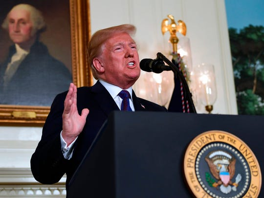 President Donald Trump speaks in the Diplomatic Reception Room of the White House on Friday, April 13, 2018, in Washington, about the United States' military response to Syria's chemical weapon attack on April 7. (AP Photo/Susan Walsh)