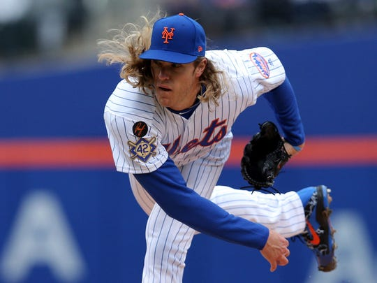 Apr 15, 2018; New York City, NY, USA; New York Mets starting pitcher Noah Syndergaard pitches against the Milwaukee Brewers during the first inning at Citi Field.