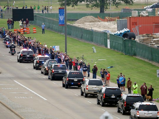 People line up to pay tribute as the motorcade carrying former first lady Barbara Bush travel through George Bush Drive, Saturday, April 21, 2018, in College Station, Texas. (AP Photo/Mark Humphrey)