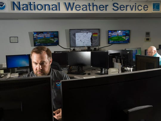 Warning coordination meteorologist Tim Halbach (left)
