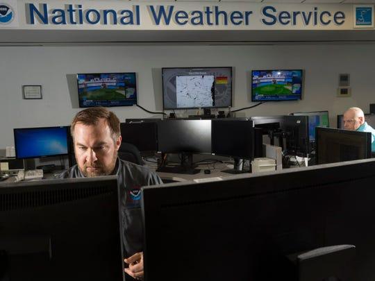 Warning coordination meteorologist Tim Halbach (left)