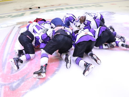 The Shreveport Mudbugs' '97s kiss the ice after Game 5 of the NAHL South Division Final on George's Pond at Hirsch Coliseum. The players born in 1997 are playing their final few games of their junior careers.