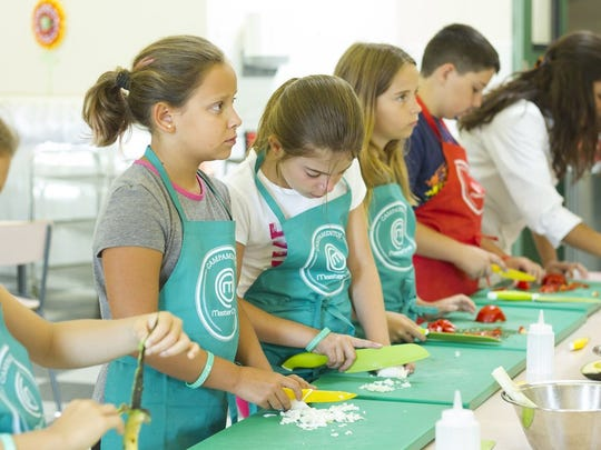 Campers at Camp MasterChef Spain await instruction on how to slice, dice and more.