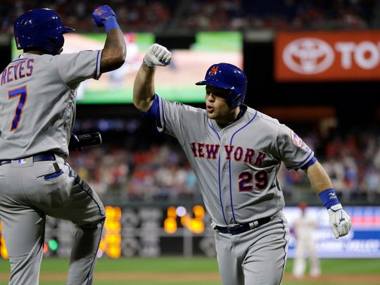New York Mets' Devin Mesoraco, right, and Jose Reyes celebrate after Mesoraco's home run off Philadelphia Phillies relief pitcher Hector Neris during the ninth inning of a baseball game Friday, May 11, 2018, in Philadelphia. New York won 3-1.