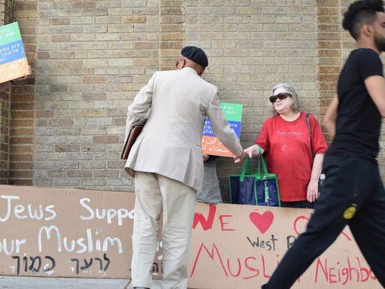 Members of Kol Tzedek Synagogue rally in support of Muslims outside the Masjid Al-Jamia mosque in West Philadelphia.