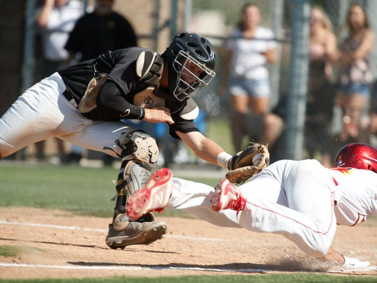 At right, Palm Desert High School's Max Puls is called out at home plate during their game Capistrano Valley during the first round CIF game at Palm Desert. Capistrano won 4-0.