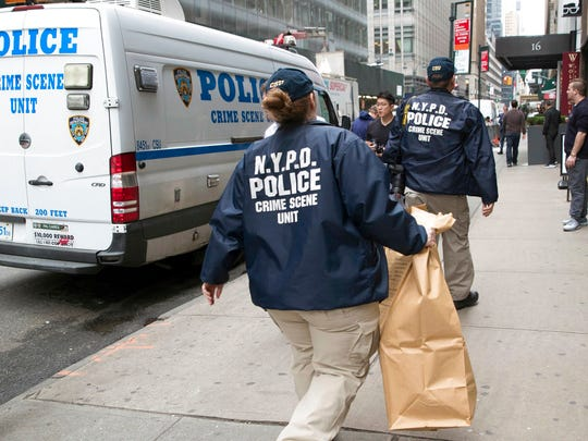 Members of the New York Police Department crime scene