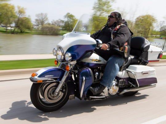 Robert Miranda, 56, rides his 2010 Harley-Davidson Electra Glide down Lincoln Memorial Drive.