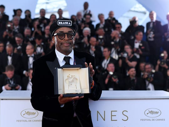 Director Spike Lee poses with the Grand Prix award
